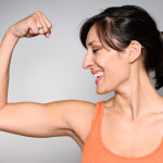 Confident Woman Flexing Muscle